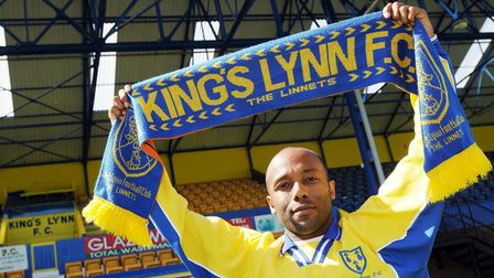 CAPTION; Photos of New King's Lynn FC player Julian Joachim, signing his contract at The Walks. Pic