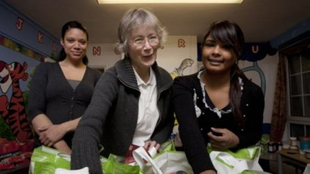 Sister Christine Frost and volunteers distributing Christmas food and gifts