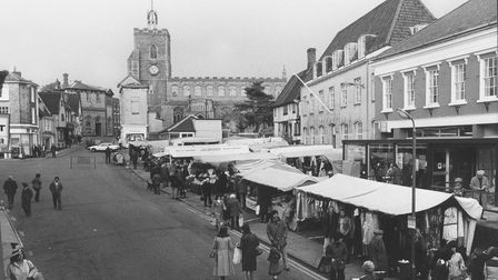 Shoppers bustle about at Diss market in 1979.