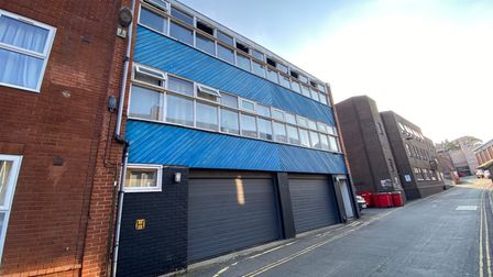 Large office block on St Faiths Lane in Norwich with two garages converted into a three-bed apartment