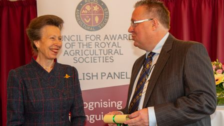 Michael Sly receiving his Fellowship of the Royal Agricultural Societies certificate from the Princess Royal