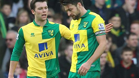 Jonny Howson consoles Russell Martin of Norwich. Picture by Paul Chesterton/Focus Images Ltd