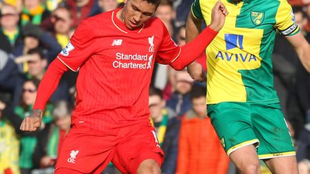 Russell Martin of Norwich and Roberto Firmino of Liverpool in action during. Picture by Paul Chester