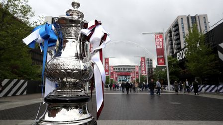 A replica of the trophy on display outside Wembley Stadium, London. Picture date: Saturday May 15, 2