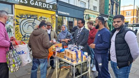 Foodbank stall in Cambridge Heath Road outside the Underground station entrance