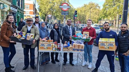 Muhi Mikdad (2nd from right) and his foodbank volunteers