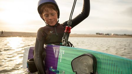 Young kitesurfer in the water