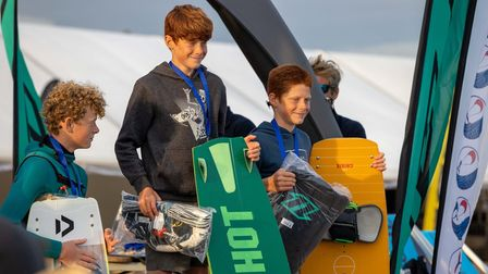 Young kitesurfers at prizegiving for winning national freestyle championships