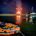 Norfolk Fireand the RNLI attended a boat engulfed in flames in Wells Harbour on October 15, 2021.