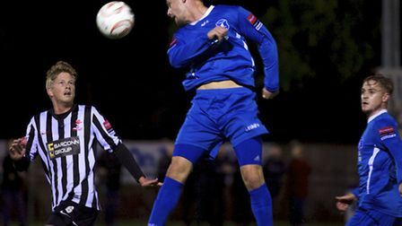 Danny Beaumont heads the ball for Wroxham during a match against Wroxham. Picture: MARK BULLIMORE