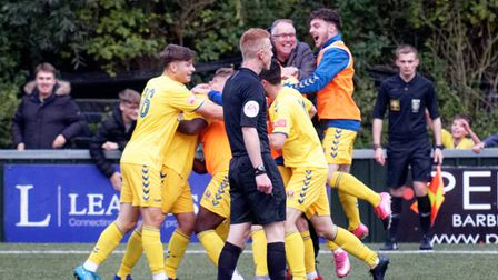 Even manager AFC Sudbury boss Rick Andrews joins the celebrations for Lewis O'Malley's match-clinchinggoal against Dartford