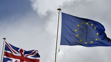 The Union flag fluttering next to the EU flag Toby Melville/PA Wire