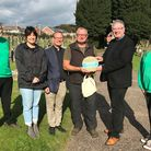 Devon CPRE presents a runner-up plaque to St Peter'sBurial Ground, Budleigh Salterton