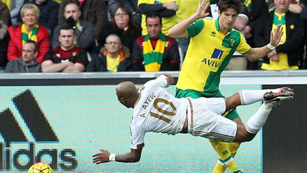 Timm Klose of Norwich and Andre Ayew of Swansea City in action. Picture by Paul Chesterton/Focus Ima