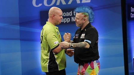 Michael van Gerwen, left, shares an embrace with Peter Wright. Picture: LAWRENCE LUSTIG/PDC