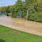 A roundabout off the A14 at Bury St Edmunds has been flooded