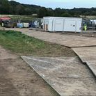 Portacabins, fencing and boards have been laid down at the site of the survey in the Wensum Valley