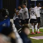 Ipswich players celebrate Sone Aluko making the score 3-0 at Portsmouth in the second half