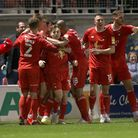 Ruel Sotiriou of Leyton Orient scores the first goal for his team and celebrates with his team mates