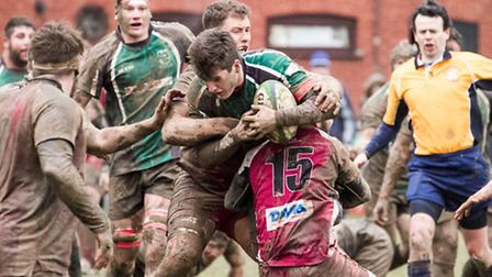 It was tough going in the rain and mud as North Walsham took on league leaders Amersham & Chiltern.