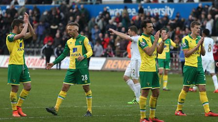 Norwich City players applaud the travelling fans at the end of the Swansea game.