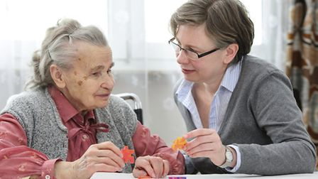 Senior woman with her elder care nurse. Photo: Getty Images.