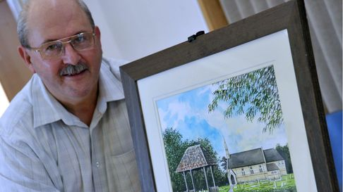 John Abbott with his painting of St Mary's Church at the exxhibition at the All Saints School in Mar