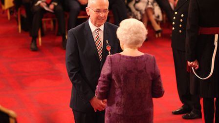 Mr. Ian Clayton from Lowestoft is made an MBE (Member of the Order of the British Empire) by Queen E