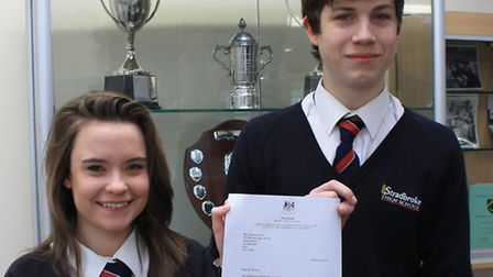 Stradbroke High School's Head girl Heather Cutler and head boy James Cleverley with the letter from