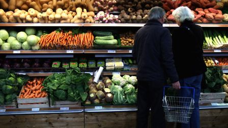 Shoppers looking at vegetables on display at a farm shop. Photo: Chris Radburn/PA Wire
