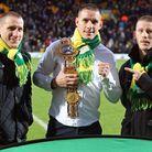 Liam Walsh, middle, and his brothers Ryan, left, and Michael at Carrow Road - but will they be back