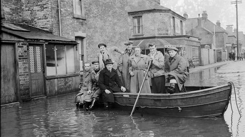 Floods 1953 - Cobholm Residents of Cobholm, Great Yarmouth outside F.W. Hayhow Stores during th