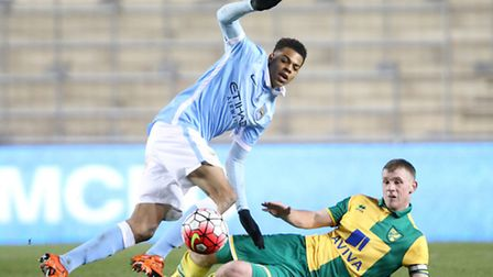Lukas Nmecha of Manchester City U18s with Joe Crowe of Norwich City U18s in Monday's Youth Cup clash