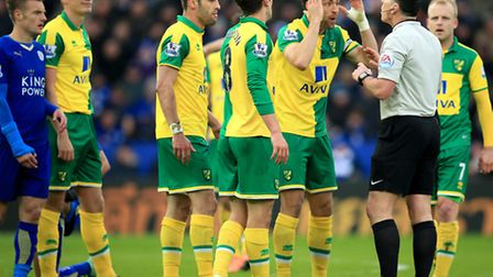 Norwich City captain Russell Martin argues with referee Neil Swarbrick during the Canaries' late def
