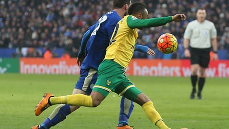 Nathan Redmond of Norwich and Christian Fuchs of Leicester City in action during the Barclays Premie