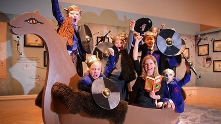 Author Cressida Cowell joins children in the A Viking's Guide to Deadly Dragons exhibition at Norwic
