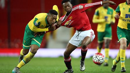 Norwich City youngster Ebou Adams in recent development action against Manchester United at Old Traf