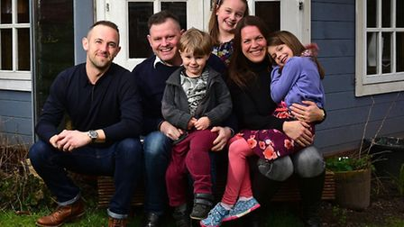 James Robinson, second left, who is recovering from a brain tumour, pictured with friend Andy Brown,