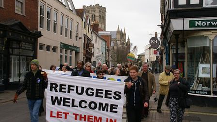 A Palm Sunday procession through Norwich urged Norfolk County Council to accept 50 Syrian refugees,
