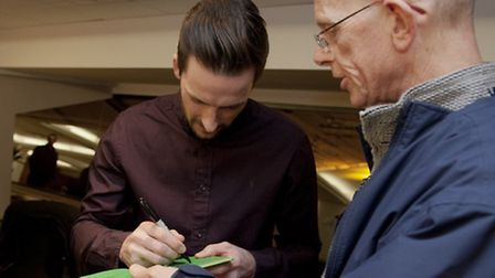 Adam Drury signs an autograph for a fan. Photos: Rob Henry