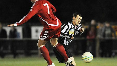 Matt Howard, right, was a rock at the heart of the Dereham defence on Saturday. Picture: IAN BURT