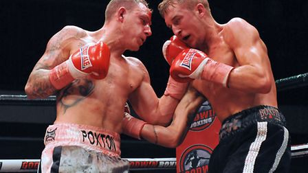 Craig Poxton in action against George Jupp.