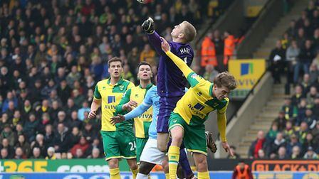 Joe Hart of Manchester City punches clear ahead of Patrick Bamford of Norwich during the Barclays Pr
