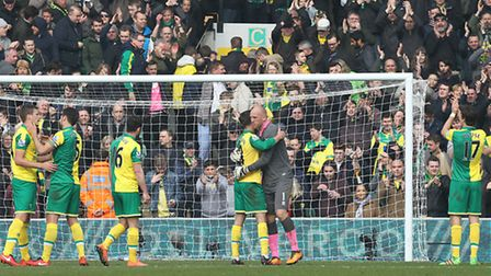 Handshakes and smiles all round as the the Norwich City players get a huge round of applause from th