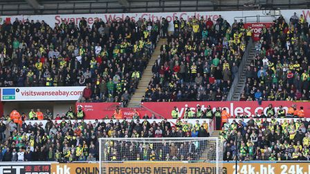 The traveling Norwich fans during the Barclays Premier League match at the Liberty Stadium, Swansea