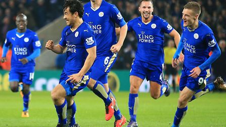 Leicester City's Shinji Okazaki (left) celebrates scoring his side's first goal of the game during t