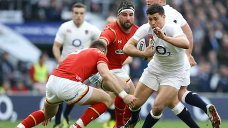 England's Ben Youngs (right) is tackled by Wales' Gareth Davies during the 2016 RBS Six Nations matc