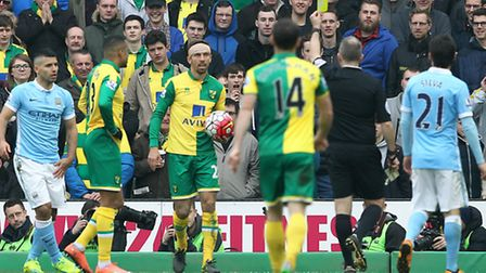 Gary OÕNeil of Norwich gets a yellow card from Referee Jonathan Moss during the Barclays Premier Lea