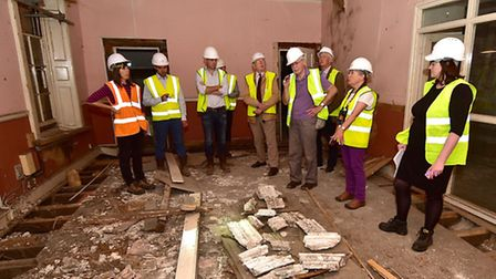 Inside Howard House. Conservation architect Ruth Brennan, orange jacket, showing members of the Norw