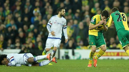 Chelsea's Willian (left) lies on the ground as Norwich City's Robbie Brady (centre) and Gary O'Neil